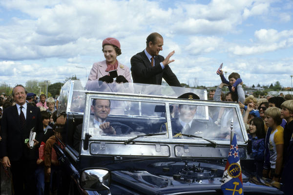 Queen Elizabeth ll and Prince Philip wave to well-wishers in October 1981 in Wellington, New Zealand. It was on that trip that the apparent assassination attempt occurred.