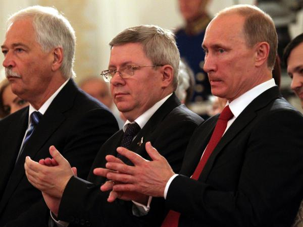 Russian politician Alexander Torshin, standing next to then-Russian Prime Minister Vladimir Putin, attends a ceremony at the Kremlin in 2011. Torshin is a lifetime member of the National Rifle Association and says he met Donald Trump through the group in 2015.