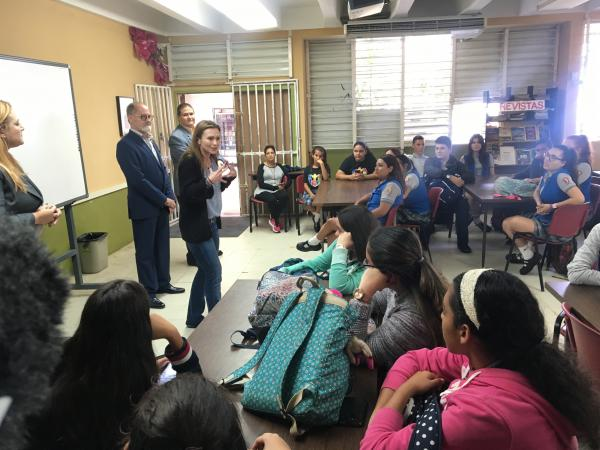 Puerto Rico Education Secretary Julia Keleher visits a high school in Arecibo, Puerto Rico, to talk to students about her proposed education reform. It would introduce charter schools to the public school system.