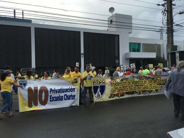 Teachers protest outside Puerto Rico's Department of Education. An education reform bill in the legislature would allow charter schools in the island's public school system, something the teachers' unions oppose.