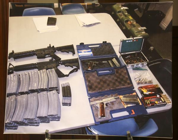 "A confiscated cache of weapons is displayed at a news conference in Los Angeles on Feb. 21. Authorities say they've thwarted a student's plot for a mass shooting at a Southern California high school. Authorities say a security guard at El Camino High School in Whittier overhead a ""disgruntled student"" threaten to open fire on the school on Friday, just two days after 17 people were gunned down at a Florida high school. Deputies discovered ""multiple guns and ammunition"" after searching the student's home. (Mike Balsamo/AP)"