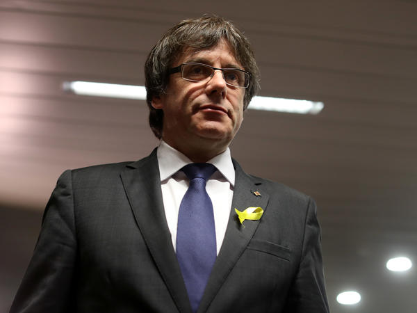 Ousted Catalan leader Carles Puigdemont — seen here in December in Brussels, where he is in exile — said Friday he no longer will pursue his bid for a second term in office.