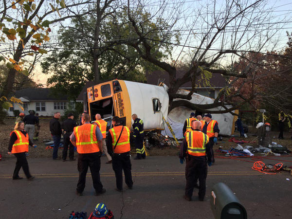 Rescuers work on the scene of a school bus crash in November 2016 in Chattanooga, Tenn. School bus driver Johnthony Walker was convicted Thursday of negligent homicide and other charges in the crash, which killed six children.