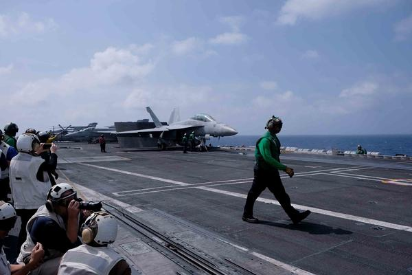 A Navy fighter jet prepares to take off from the deck of the aircraft carrier USS Carl Vinson in the South China Sea. The carrier is on its second extended deployment in the Western Pacific in two years.