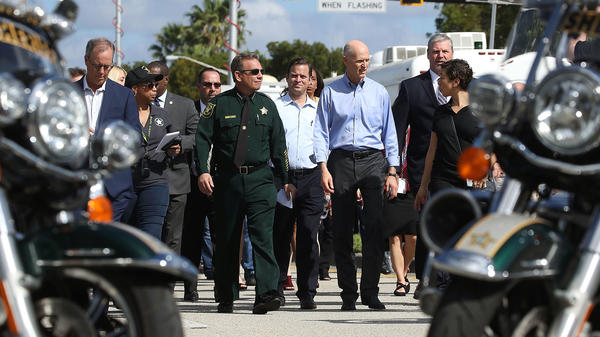Broward County Sheriff Scott Israel, center in uniform, is facing criticism over his department's response to last month's Parkland, Fla. school shooting.