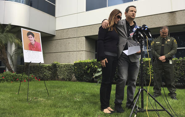 Jeanne and Gideon Bernstein, parents of Blaze Bernstein (pictured behind them), speak at a news conference in Lake Forest, Calif., in January. Former classmate Sam Woodward, an alleged neo-Nazi, has been charged with fatally stabbing Bernstein.