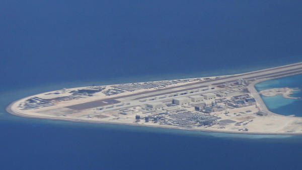 An airstrip, structures and buildings on the man-made Subi Reef in the Spratly chain of islands in the South China Sea are seen from a Philippine Air Force C-130 transport plane last year.