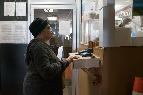 Pauletta Jackson drops off her prescription for Suboxone at the pharmacy just downstairs from Chapman's clinic.