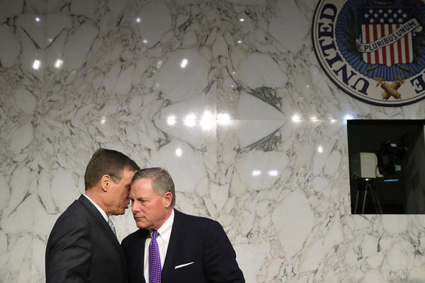 Senate intelligence committee vice chairman Sen. Mark Warner, D-Va., (left) and chairman Sen. Richard Burr, R-N.C., confer after hearing testimony from intelligence officials, including the heads of the FBI, CIA and NSA on Capitol Hill February 13, 2018.