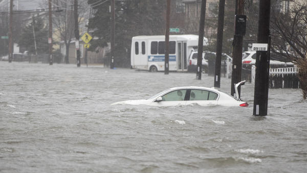 A flooded car sits in Hough's Neck on Friday in Quincy, Mass. A nor'easter hit the east coast on Friday, bringing coastal flooding, heavy snow and strong winds to the area.
