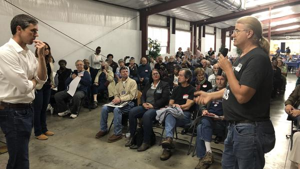 Rep. Beto O'Rourke, the Texas Democrat challenging Sen. Ted Cruz's re-election bid this year, speaks to voter Mike Nichols at an event in Pittsburg, Texas. More than 100 people showed up to the event, in a town of just over 4,700.