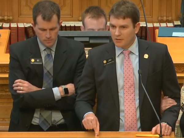 Colorado state Reps. Alec Garnett (right) and Matt Gray (left) said that in recent weeks they had taken to wearing bulletproof vests while at the Capitol for fear of violence from a fellow member who was expelled Friday.
