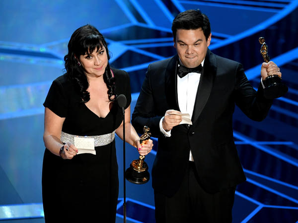 Songwriters Kristen Anderson-Lopez and Robert Lopez accept their Oscar awards for Best Original Song on Sunday night.