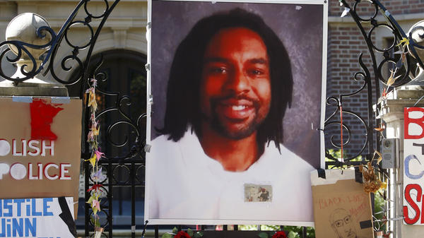 A memorial with a photo of Philando Castile adorns the gate to the governor's residence in St. Paul, Minn., in 2016.