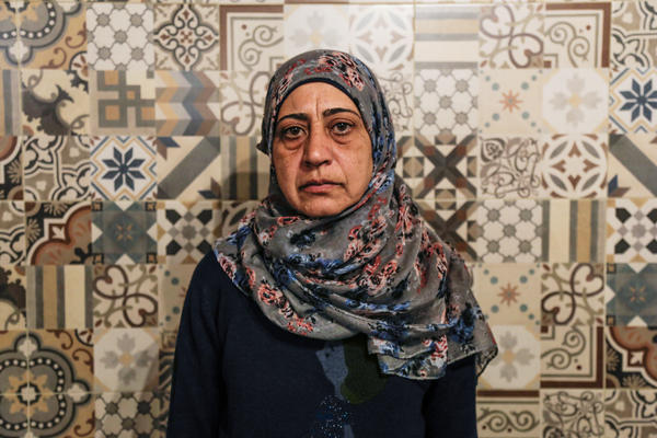 """Amal Adwan, a 47-year-old teacher from Damascus, Syria, must stay on Lesbos until she exhausts all appeals for her asylum request, which was denied on the basis that Turkey is a safe country. """"Syrians face discrimination in Turkey,"""" she says. """"We cannot find work, and if we do, they don't pay us."""""""