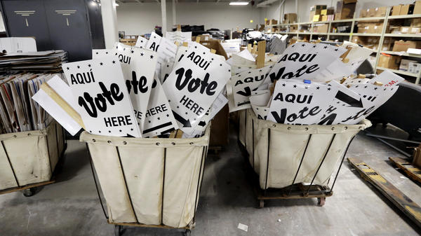 Bins of signs are seen in a storage area at the Bexar County Election offices last month in San Antonio.