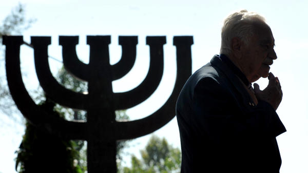 A man attends the 70th anniversary memorial at the Minora Monument for victims of the 1941 Nazi massacre of Jews in Babi Yar ravine, Kiev. Nazis murdered 33,771 Jews there over the two days Sept. 29-30, 1941. A new collection of Jewish songs from the period thought to have been lost — one of which addresses the massacre at Babi Yar — has now been reconstructed and released.