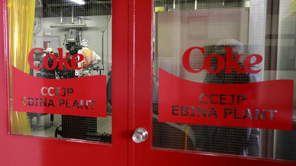 The Coke logo is seen on the door of the Coca-Cola Ebina plant in the Kanagawa Prefecture, near Tokyo, in 2016. Coca-Cola is planning to launch its first alcoholic drink, in Japan.