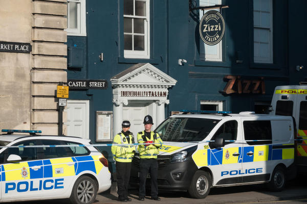 "Police officers stand outside a branch of the Italian chain restaurant Zizzi close to The Maltings shopping center in Salisbury which has been closed in connection with an ongoing major incident sparked after a man and a woman were found critically ill on a bench outside the shopping center on Sunday,March 7, 2018 in Wiltshire, England. Sergei Skripal, who was granted refuge in the U.K. following a ""spy swap"" between the U.S. and Russia in 2010, and his daughter, remain critically ill after being exposed to an ""unknown substance."" (Matt Cardy/Getty Images)"