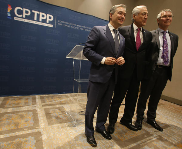 Canadian Trade Minister Francois-Philippe Champagne (from left), Chilean Foreign Minister Heraldo Muñoz and New Zealand Trade and Export Growth Minister David Parker are among those signing the rebranded pact Thursday in Santiago, Chile.