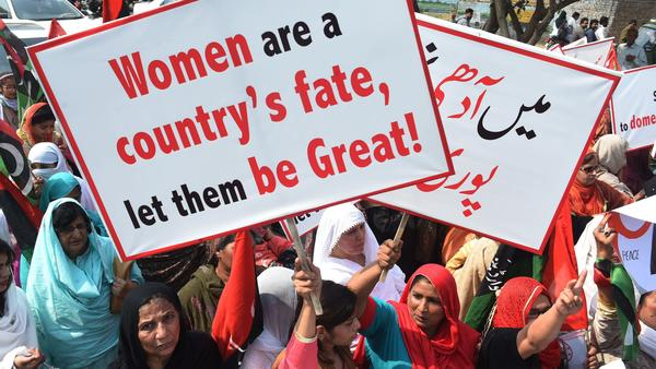 Supporters of the Pakistan Peoples Party chant slogans as they march in Lahore to mark International Women's Day.