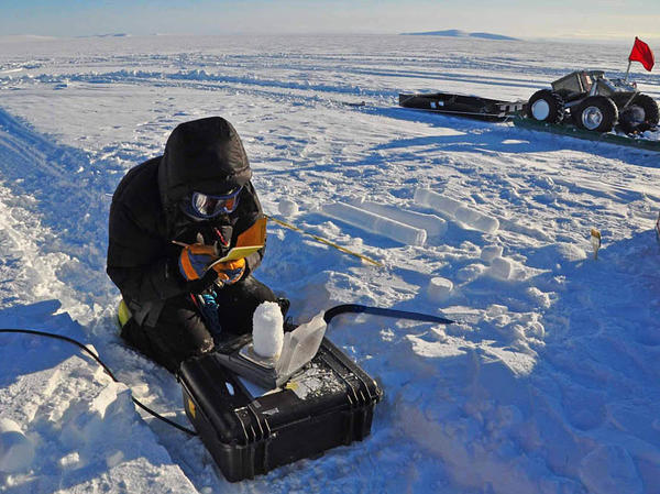 Zoe Courville takes snow density measurements in Greenland in 2014.