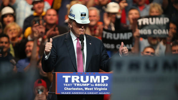 Then-presidential candidate Donald Trump models a hard hat during his rally at the Charleston Civic Center on May 5, 2016 in Charleston, West Virginia.