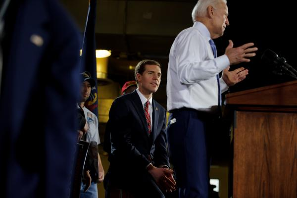 Democratic congressional candidate Conor Lamb listens as former Vice President Joe Biden speaks at a rally on Tuesday, March 6, 2018 in Pittsburgh.