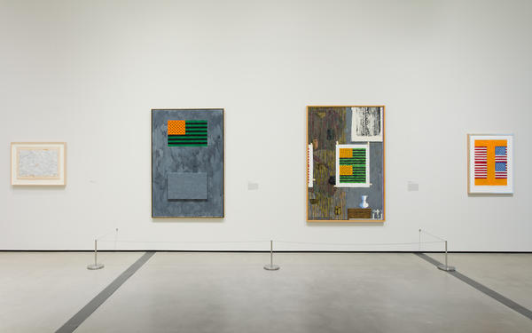 "As exhibited at The Broad, Jasper Johns' ""Flags"" from 1965 (center-left) sits next to ""Ventriloquist"" from 1983."