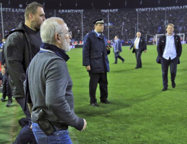 PAOK owner Ivan Savvidis invades the pitch during the Greek League soccer match between PAOK and AEK Athens in the northern Greek city of Thessaloniki on Sunday.