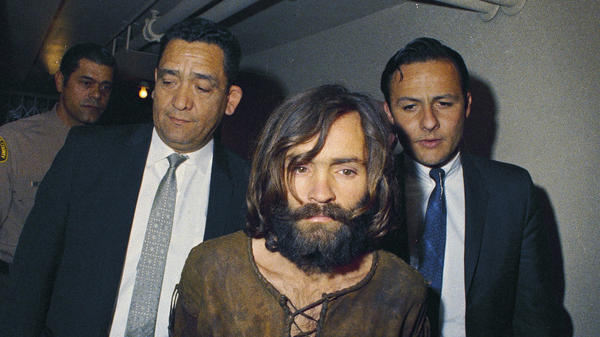 Charles Manson is escorted to his arraignment in 1969 on conspiracy-murder charges in connection with the Sharon Tate murder case.