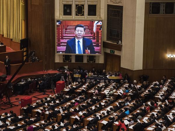 China's President Xi Jinping is seen on a large screen over delegates as he joins a session of the National People's Congress to vote on a constitutional amendment March 11. Chinese lawmakers abolished presidential term limits and paved the way for Xi Jinping to rule indefinitely.