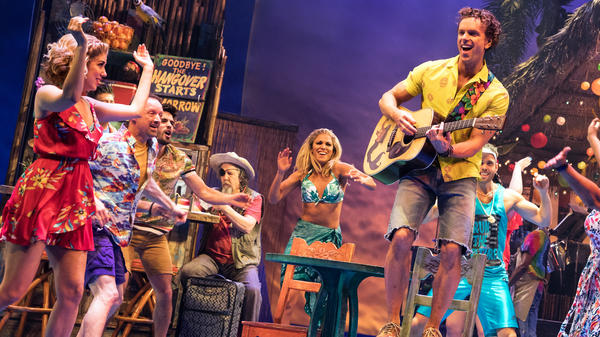 A scene from Jimmy Buffett's Broadway musical <em>Escape to Margaritaville</em>.