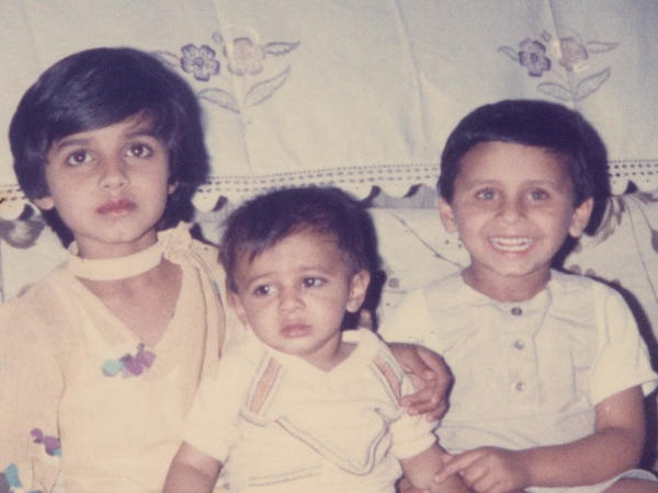 A young Muhammad Faridi (right) with his sister and little brother while still in Pakistan.