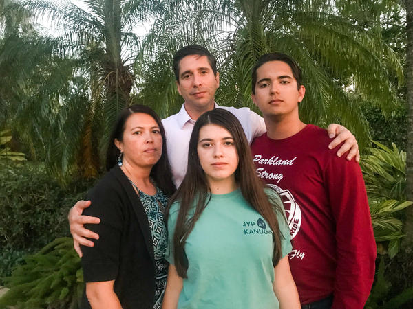 The Schentrup family stands for a group portrait outside their home in Parkland, Fla., on Tuesday.