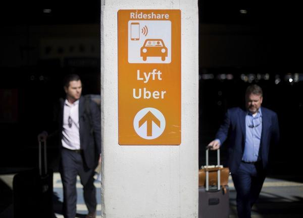A sign directs Lyft and Uber riders to a designated pickup location at Hartsfield-Jackson Atlanta International Airport in Atlanta, Wednesday, Jan. 31, 2018. (David Goldman/AP)