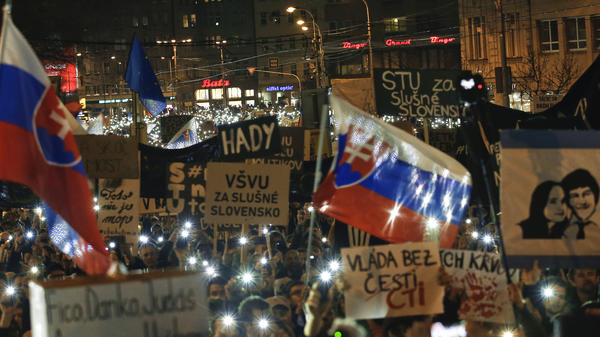 People flash the lights of their mobile phones as they celebrate the resignation of Prime Minister Robert Fico and his government as a way out of the political crisis triggered by the killings of investigative journalist Ján Kuciak and his fiancée Martina Kusnírová, during a rally in Bratislava, Slovakia on Friday.