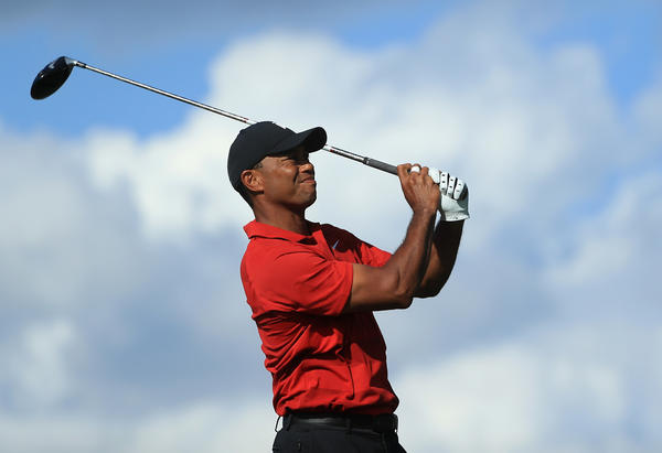 Tiger Woods plays his shot from the 16th tee Sunday during the final round of the Arnold Palmer Invitational at Bay Hill Club and Lodge in Orlando.