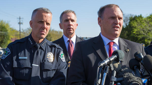 Austin Police Chief Brian Manley (from left), ATF Special Agent in Charge Fred Milanowski and FBI Special Agent in Charge Christopher Combs at a news conference on Monday in Austin, Texas. They said a bomb that exploded Sunday night appeared to have used a tripwire.