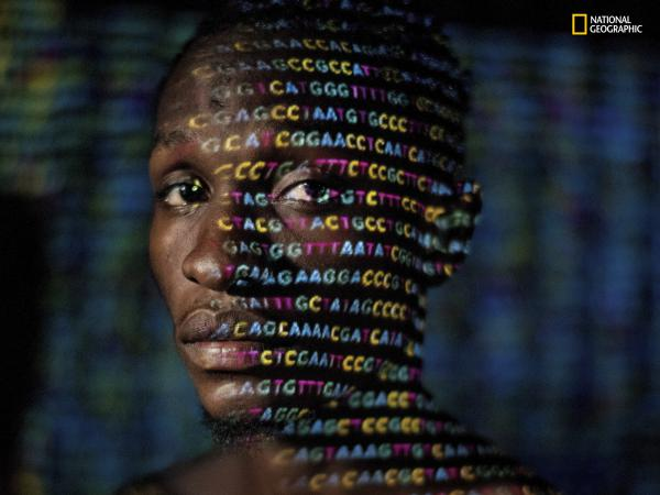 In the April issue of <em>National Geographic</em>, the four letters that represent the genetic code — A, C, G and T — are projected onto Ryan Lingarmillar, a Ugandan.