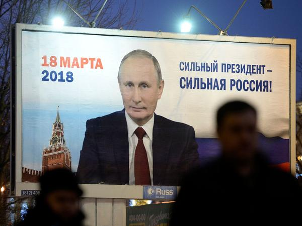 "A billboard in St. Petersburg, Russia, shows an image of Russia's President Vladimir Putin in January. The sign says, ""Strong president — Strong Russia."""