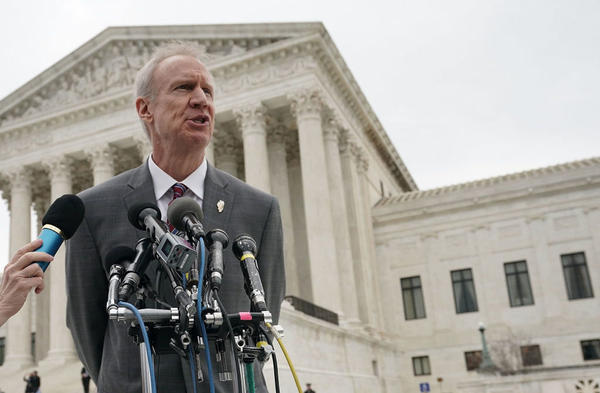 Gov. Bruce Rauner, R-Ill., speaks to members of the media in front of the U.S. Supreme Court after a hearing earlier this year.