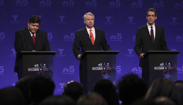 Democrats running for Illinois governor from left, billionaire J.B. Pritzker, businessman Chris Kennedy, and state Sen. Daniel Biss take their podium positions before a televised forum in January.