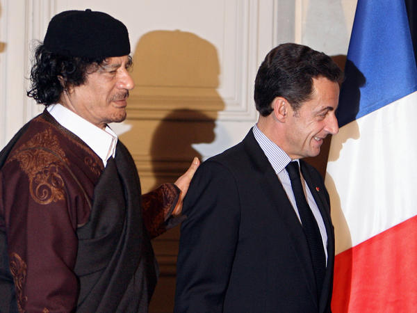 French President Nicolas Sarkozy (right) and Libyan leader Moammar Gadhafi leave the Elysee Palace after the signature of 10 billion euros of trade contracts between the two countries, in December 2007 in Paris.