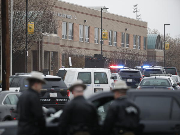 """Deputies and federal agents converge on Great Mills High School in Great Mills, Md. Authorities have said the situation is """"contained."""""""