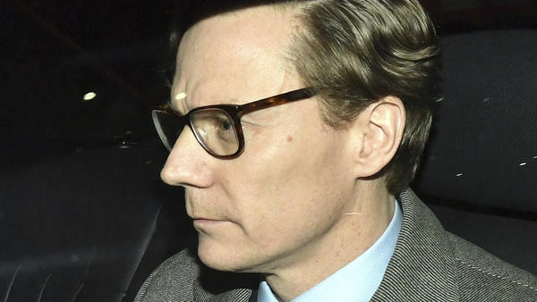Cambridge Analytica Chief Executive Alexander Nix leaves the company's offices in central London on Tuesday. He was suspended amid a controversy about the company's use of social media data.