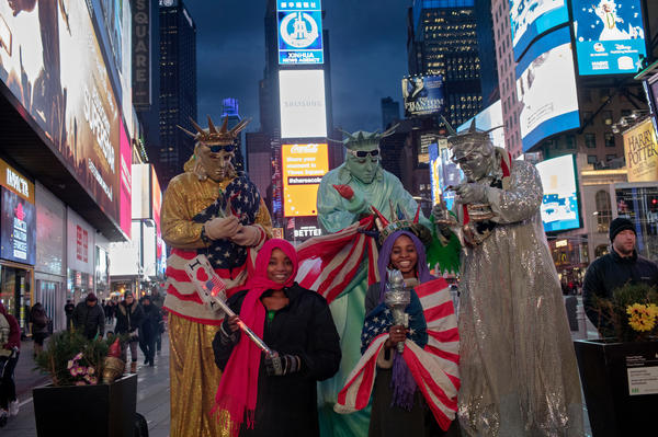 Ya Kaka, left, and Hauwa, right, who were captured by Boko Haram in 2014, pose with Statue of Liberty impersonators in Times Square.