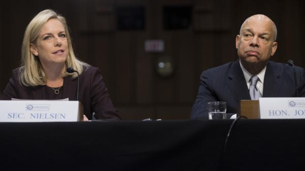 Secretary of Homeland Security Kirstjen Nielsen (left) and former Secretary of Homeland Security Jeh Johnson (right) testify about election security during a Senate intelligence committee hearing on Capitol Hill Wednesday.