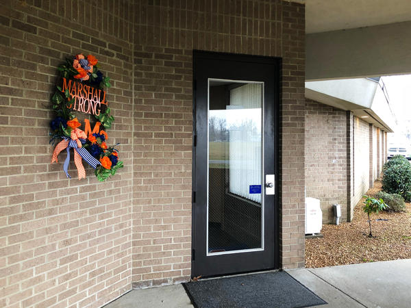 """A """"Marshall Strong"""" wreath hangs at the Marshall County school board building in Benton, Ky."""