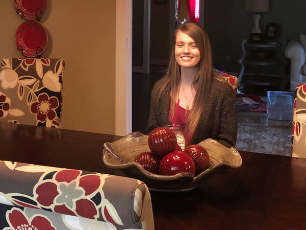 Leighton Solomon, a junior at Marshall County High School, sits in her family's dining room. She was never political, she says — but she's started campaigning to promote school safety, after being inspired by the students at Stoneman Jackson.